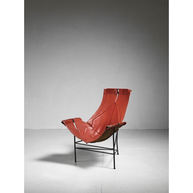 Leather sling chair made of a black metal base and brown saddle leather by Leathercrafter, New York.