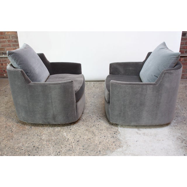 Pair of Barrel-back chairs composed of 'block' stained mahogany feet and newly upholstered frame in Kravet 'gun-metal...