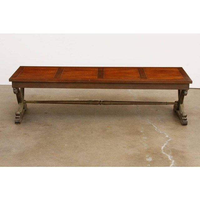 Rare T.H. Robsjohn-Gibbings (1905-1976) cocktail table for Baker furniture made in the neoclassical taste. Features an...
