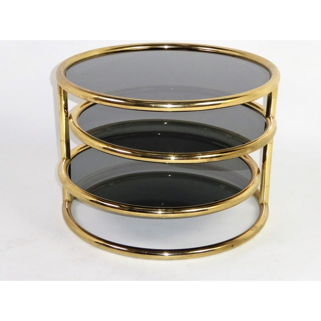 Hollywood Regency 1970s Three Tier Brass With Smoked Glass Coffee Table For Sale - Image 3 of 12