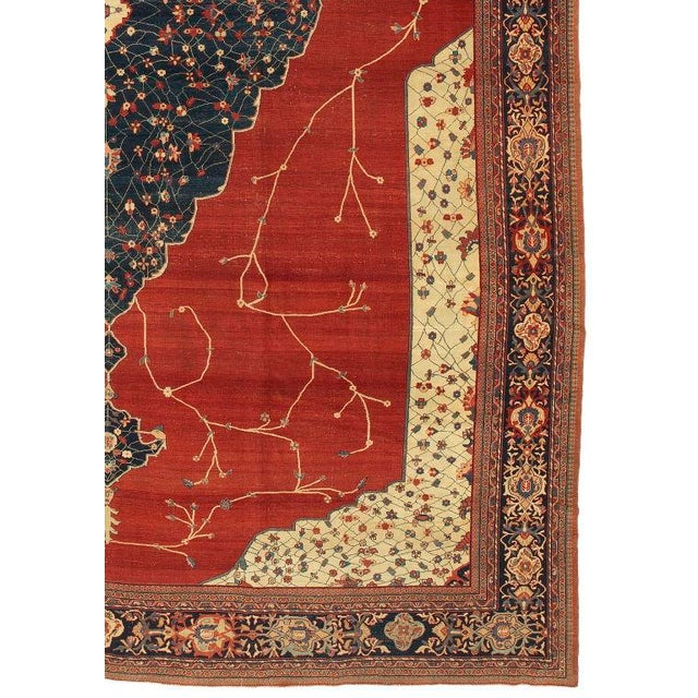 This magnificent central Persian carpet on a rich madder red ground was woven during the heyday of a renaissance in...