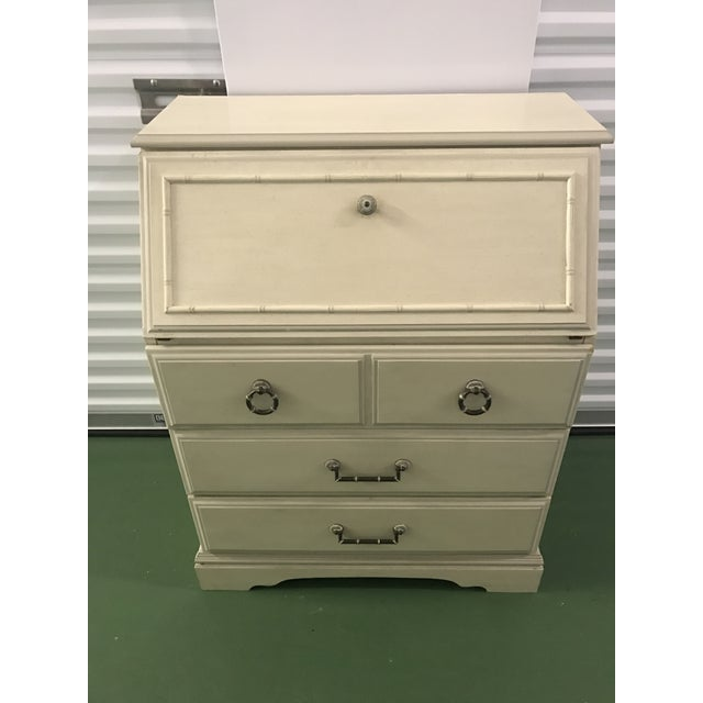 A petite faux bamboo secretary desk with bamboo hardware. Three drawers on wooden slides; all drawers slide easily....