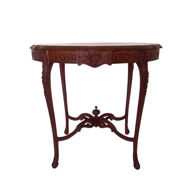 Elegant 1920s - 1930s walnut occasional /centre or side table made by Weiman Heirloom, Rockford, IL, with ornate lower...