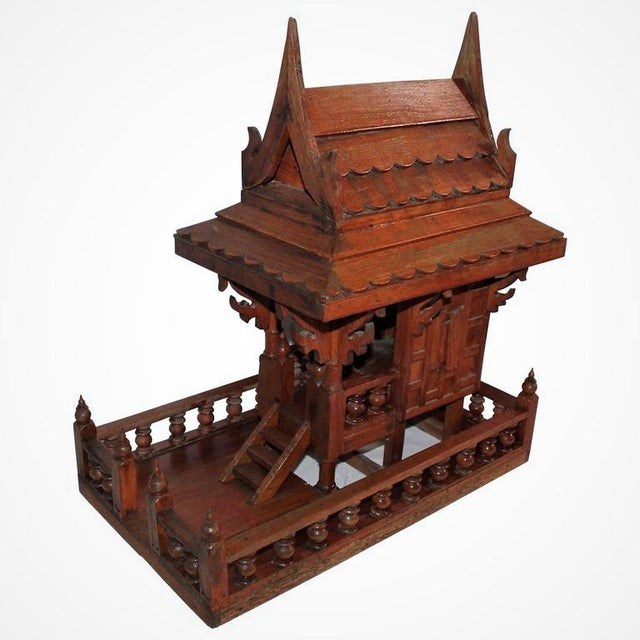 This is quite unusual piece of folk art. It looks like an architect's model of a boat house. It is probably from the 1930s...