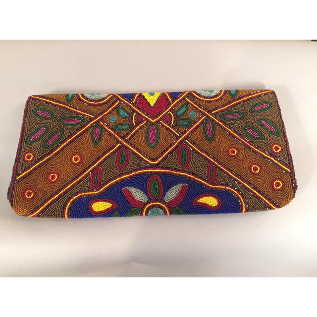 "A spectacular multi-color, oversized, 1930's beaded clutch in pristine condition is a very rare find. This bag is 7"" high..."