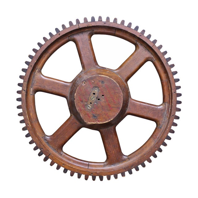 Industrial chic in the form of a vintage wood gear, originally used to cast foundry parts. Wood pieces that make up the...