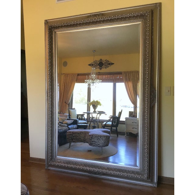 This tall leaning floor mirror brightens any room and makes it look even larger being almost ceiling height. It is a one...