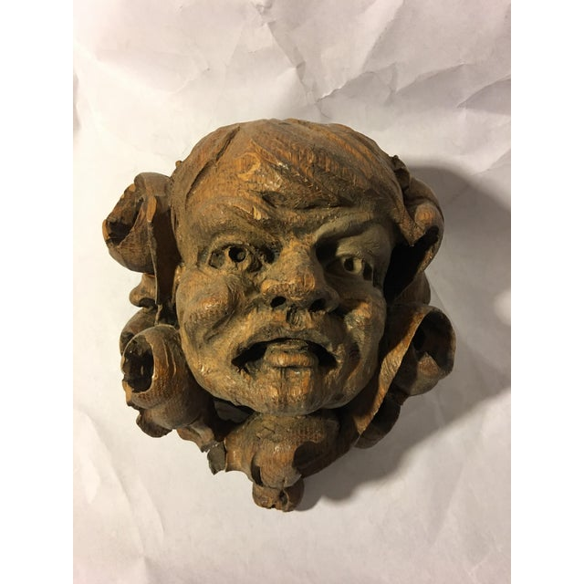 A beautiful cherubic carved oak German Gargoyle from a room of paneling. Over 100 years old. Wonderful details. In good...