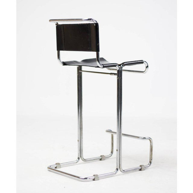 Unique pair of vintage leather and chrome stendig bar stools. With the original black saddle leather sling seat and back....