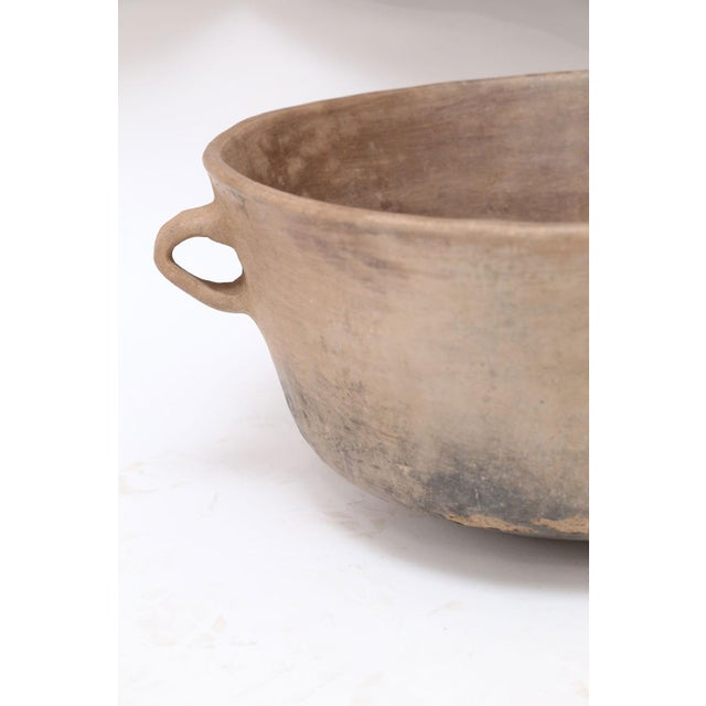 Primitive clay cooking bowl from Los Reyes Metzontla, Mexico. This vintage vessel is hand-sculpted, created and used circa...
