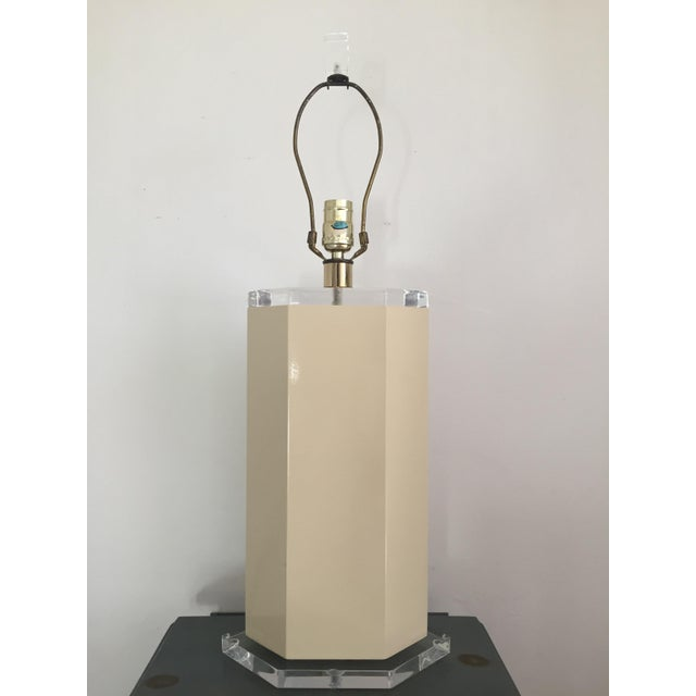 Fantastic vintage off white table lamp in the shape of a hexagon, circa 1970s. Supported by hexagon lucite base. Would be...