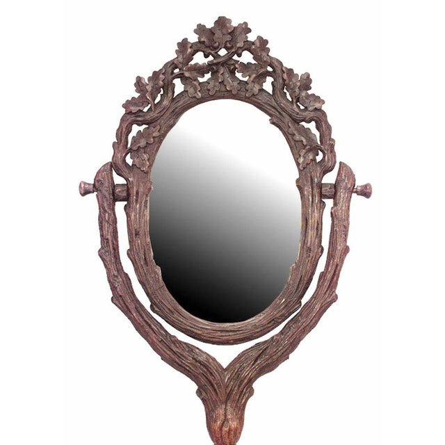 Rustic Black Forest (19th century) carved walnut shaving mirror with carved woven shelf with drawer.