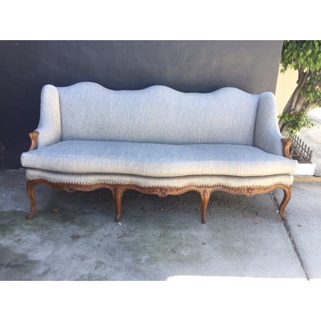 18th century French walnut camel back sofa. Newly upholstered.