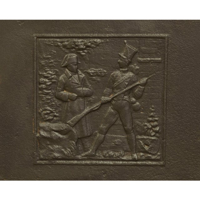 This square French cast iron fireback shows Napoleon Bonaparte on the battlefield with a soldier, 19th century. Great...