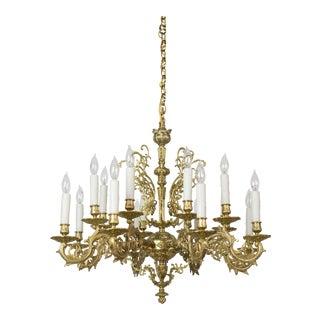 Sixteen Light Cast Brass Chandelier For Sale