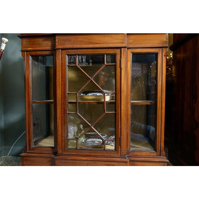 Beautiful, mahogany vitrine cabinet with fine detailed inlay having a block front design on the front bottom and elaborate...