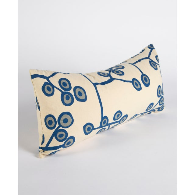"""This cream lumbar pillow measures 24""""x12"""" and features a blue and gray hand drawn botanical pattern. This pillow adds the..."""