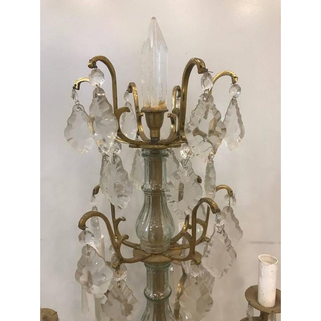 Pair of Louis XVI style six-light candelabras, crystal prisms with a marble bases.