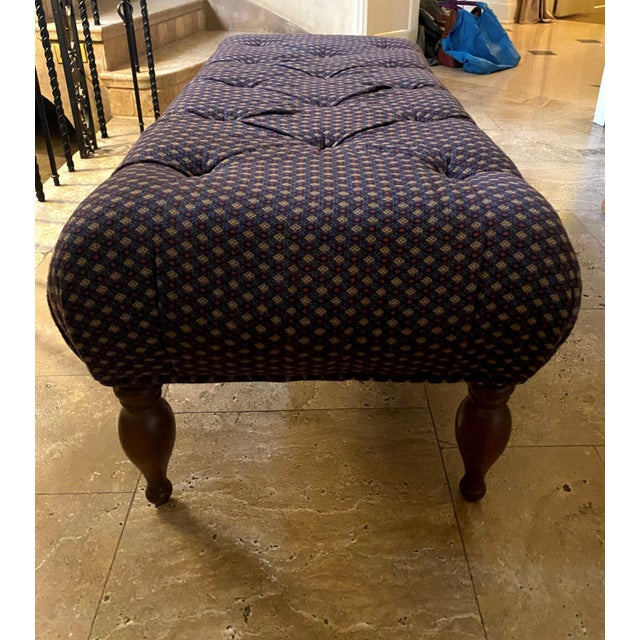 Ottoman by Lee Industries. Attractive tufting and beautiful turned leg.
