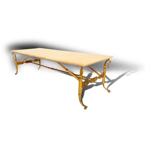 For your consideration a coffee table designed by Arturo Pani. Sculptural and decorative brass frame with parchment top....