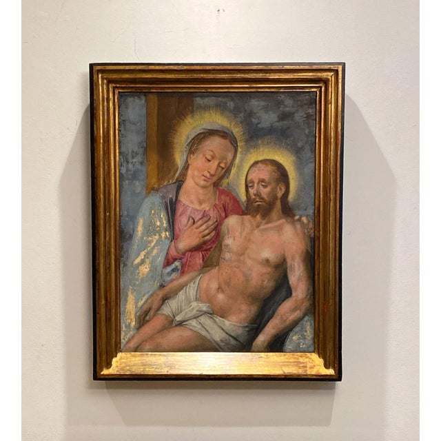 An early 18th Century oil on board of Mary Magdalene holding Jesus.