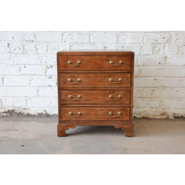 Offering a very nice walnut chest by Davis Cabinet Co. of Nashville, TN. The chest has four smooth sliding drawers and is...