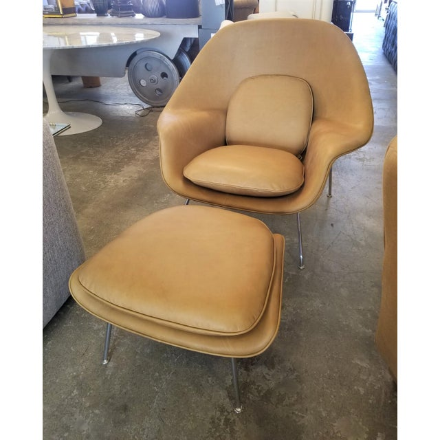 This is a leather Saarinen leather upholstered chair and ottoman set. It's in great condition with only slight patina on...