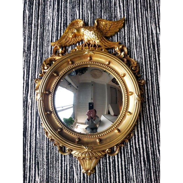 A handsome, federal eagle convex mirror, crafted of resin with a gilded finish. A classic example of traditional Americana.