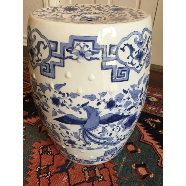 A lovely vintage blue and white ceramic Chinoiserie ceramic garden stool. This is a large garden stool with exquisite,...