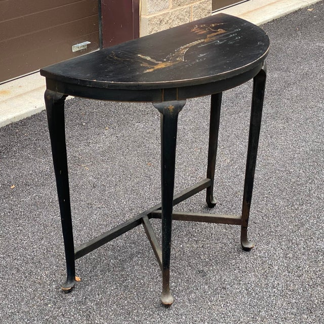 A charming antique demilune chinoiserie accent table estate fresh with an unrestored finish!