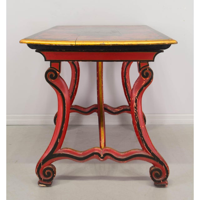 Spanish baroque style table. Hand carved base with original old painted patina. Top is richly decorated in black, red and...