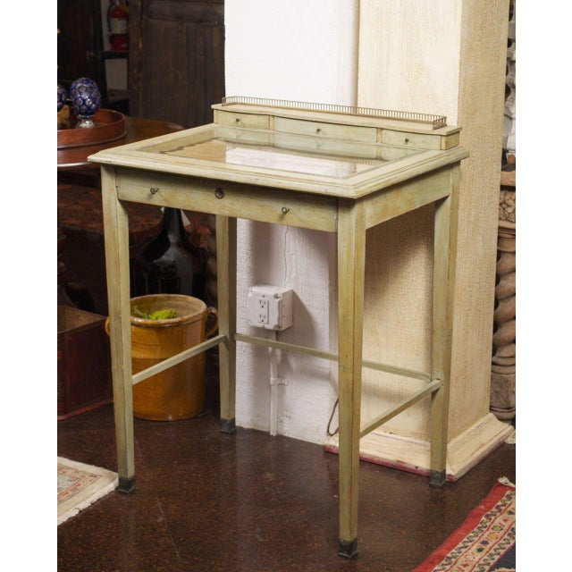 Painted Collector's Display Table, painted pale green, brass gallery. French, circa 1880.