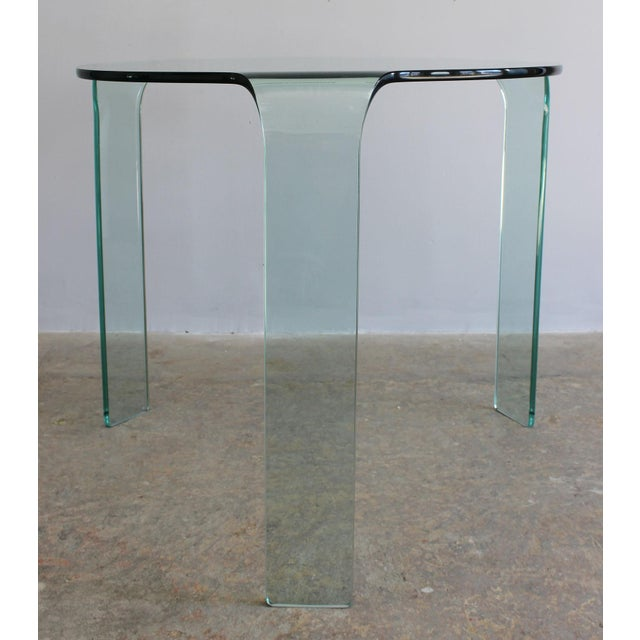 A Fiam Italia tempered molded glass tripod dining or accent table.