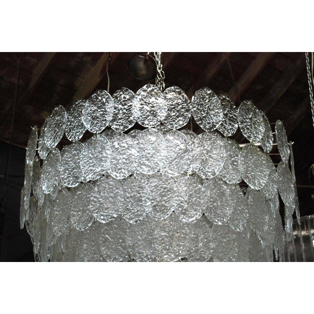 Vintage Italian chandelier with clear Murano oval discs and nickel frame by Vistosi / Made in Italy in the 1960s 28 lights...