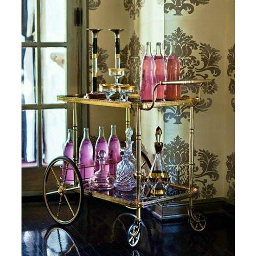 Hollywood Regency vintage Maison Bagues brass black glass gilt bar tea cart trolley - French table - Rue Magazine featured...