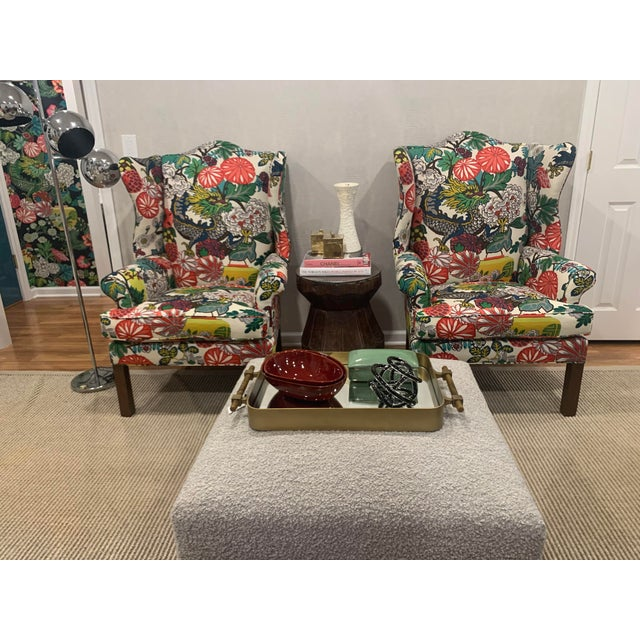 We took a traditional wing chair and gave it moderna modern update with F Schumacher'a Mai Dragon fabric. The scale and...