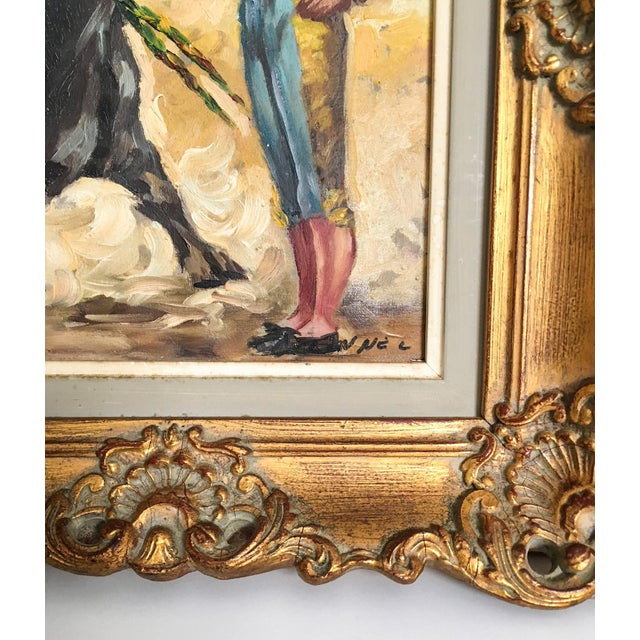 An exquisite offering of a 1920s oil on canvas applied to board painting of a Spanish matador or toreador with a bull. The...
