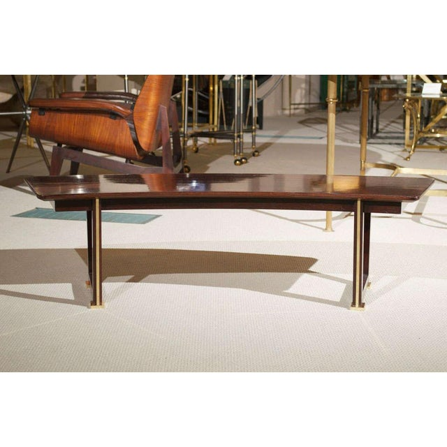 An exceptional Jules Leleu parquetry table in rosewood, uniquely shaped with gilt/bronze detailing on the base. France,...