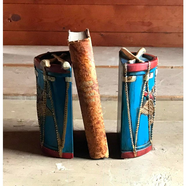 Offering a colorful pair of patriotic bookends, crafted in the sculptural shape of two pieces of a drum. Eagles with...
