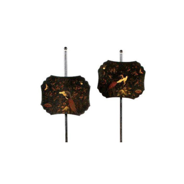 One pair of lacquered pole fire screens accents.