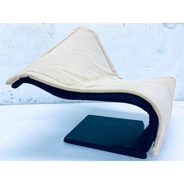 Flying Carpet lounge chair made with detachable beige suede fabric and black backing and a matte black steel base by Simon...