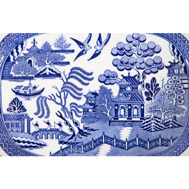 """A superb 19th-Century English Staffordshire transferware platter in the classic Blue Willow pattern. Marked """"England"""" on..."""