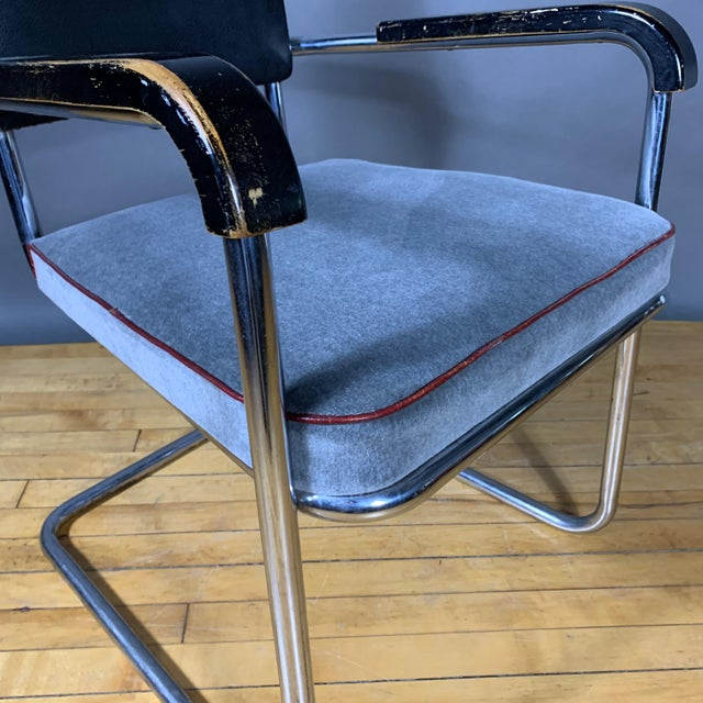 Probably by Drabert Germany, this cantilever armchair is made with two connected and shaped pieces of tubular chrome. Arms...