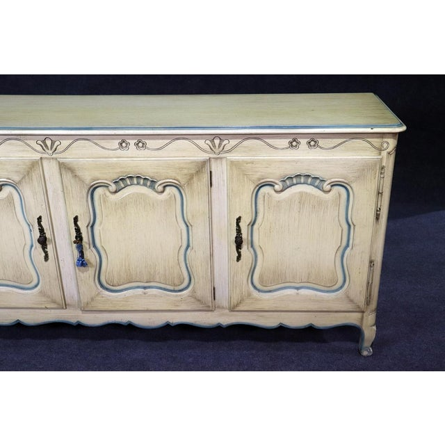 French Louis XV style paint decorated sideboard with 3 doors containing 2 shelves and 2 drawers.