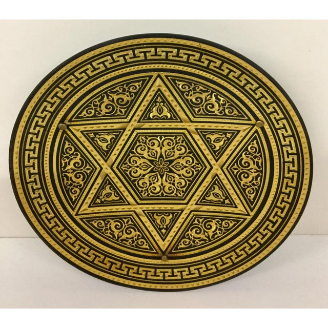 This hand forged little tray is made of black cast iron and then electroplated with gold to give it the rich bright...