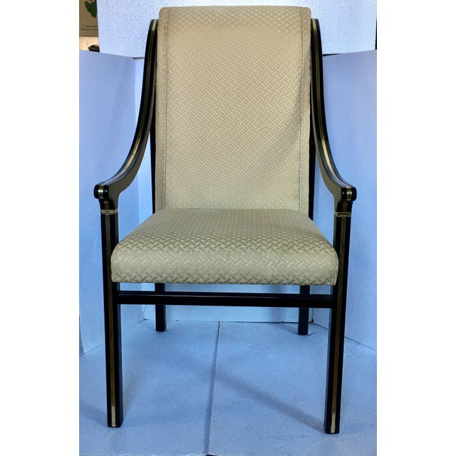 Elegant and sleek hollywood regency style dining chairs by Mastercraft. These Mid-Century Modern sculptural arm chairs...