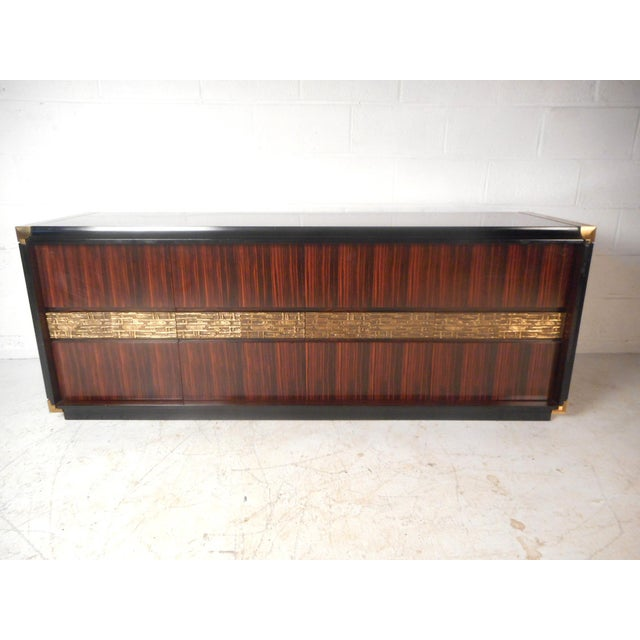 This stunning Italian vintage modern credenza features plenty of room for storage within its four hefty drawers and large...
