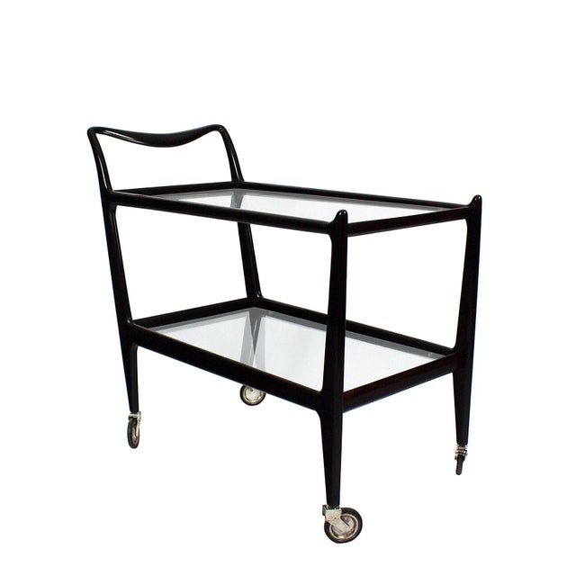 Two levels bar cart, stained beech, french poilish, chrome plated wheels and glass. Design: Ico Parisi. Italy c. 1950...