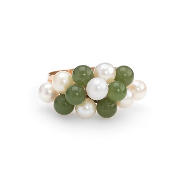 Elegant vintage ring (circa 1950s to 1960s), crafted in 14 karat yellow gold. 7 cultured pearls range in size from 4mm to...