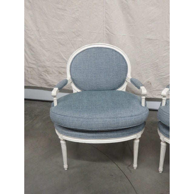 Pair of Louis XVI style distressed finished armchairs.